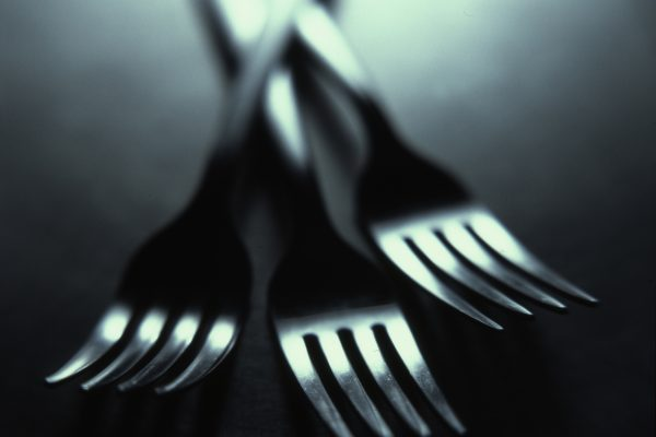 Forks that represent fat laced foods and weight loss